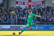 AFC Wimbledon goalkeeper Aaron Ramsdale (35) clearing the ball in front of AFC Wimbledon banner during the EFL Sky Bet League 1 match between AFC Wimbledon and Charlton Athletic at the Cherry Red Records Stadium, Kingston, England on 23 February 2019.