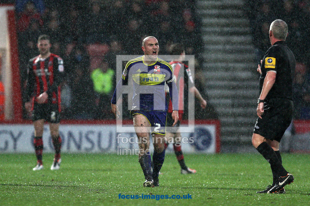 Picture by Daniel Chesterton/Focus Images Ltd +44 7966 018899.12/01/2013.Alan McCormack of Swindon Town contests a decision with the referee during the npower League 1 match at the Seward Stadium, Bournemouth.