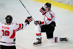 Maximilian Wilfan and David Lindner of Austria celebrate  during the ice hockey match between National teams of Lithuania (LTU) and Austria (AUT) at 2011 IIHF World U20 Championship Division I - Group B, on December 12, 2010 in Ice skating Arena, Bled, Slovenia.  (Photo By Vid Ponikvar / Sportida.com)