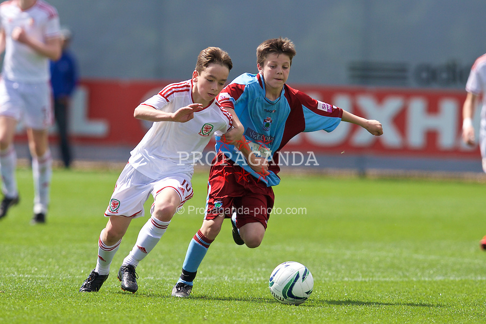 NEWPORT, WALES - Thursday, May 28, 2015: Regional Development Boys' Toby Maguire and North WPL Academy Boys' Matthew Jones during the Welsh Football Trust Cymru Cup 2015 at Dragon Park. (Pic by David Rawcliffe/Propaganda)