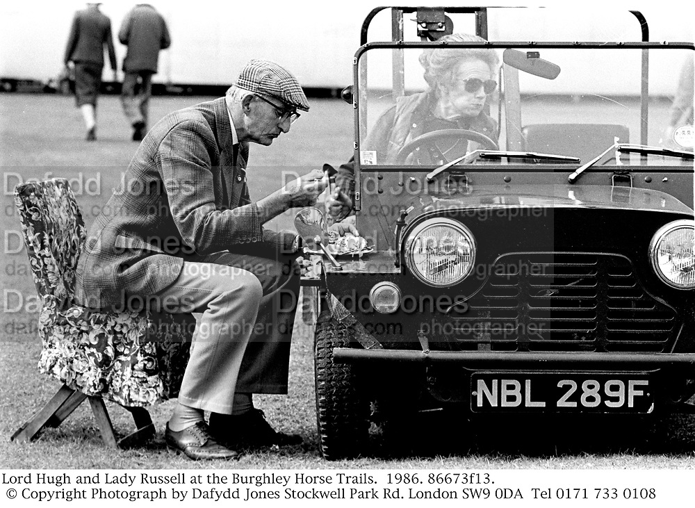 Lord Hugh and Lady Russell at the Burghley Horse Trails.  1986. 86673f13. © Copyright Photograph by Dafydd Jones<br />
