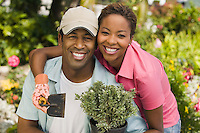 Couple Working in Garden Together