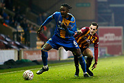 Omar Beckles of Shrewsbury has his shirt tugged by Bradford City's Dylan Connolly(19) during the The FA Cup match between Bradford City and Shrewsbury Town at the Utilita Energy Stadium, Bradford, England on 19 November 2019.