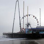 Seaside Heights boardwalk with ferris wheel immediately after Hurricane Ida