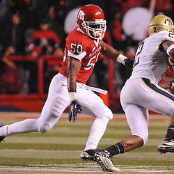 Oct 16, 2009; Piscataway, NJ, USA; Pittsburgh tight end Dorin Dickerson (2) runs past Rutgers linebacker Antonio Lowery (50) during first half NCAA football action between Rutgers and Pittsburgh at Rutgers Stadium.