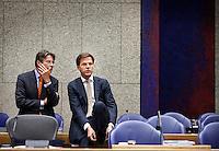 Nederland. Den Haag, 27 oktober 2010.<br /> De Tweede Kamer debatteert over de regeringsverklaring van het kabinet Rutte.<br /> Vicepremier Maxime Verhagen en premier Mark Rutte<br /> Kabinet Rutte, regeringsverklaring, tweede kamer, politiek, democratie. regeerakkoord, gedoogsteun, minderheidskabinet, eerste kabinet Rutte, Rutte1, Rutte I, debat, parlement<br /> Foto Martijn Beekman