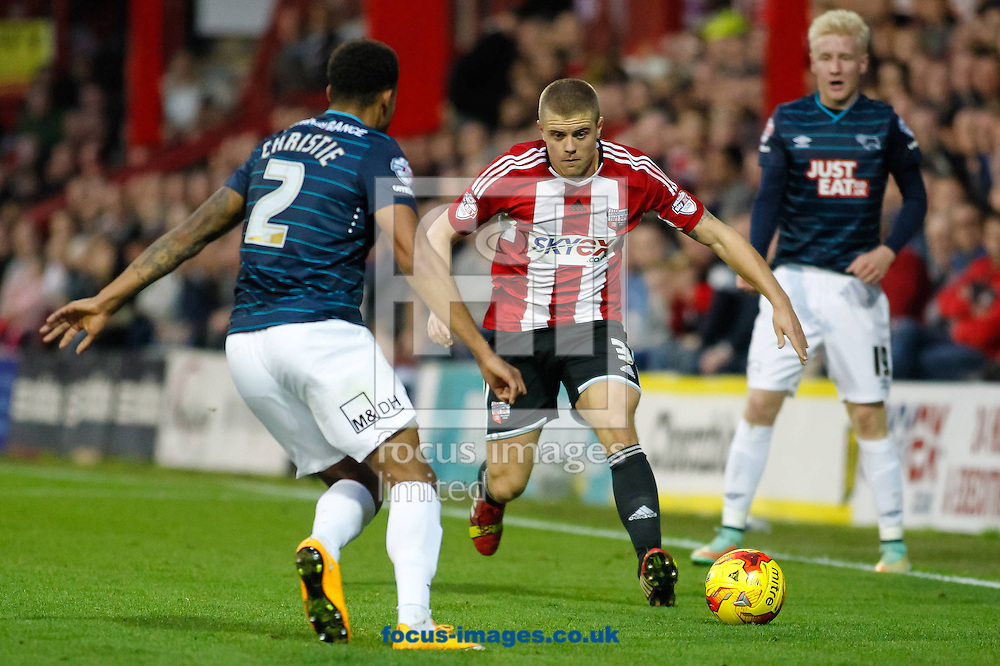 Cyrus Christie of Derby County Jake Bidwell of Brentford during the Sky Bet Championship match between Brentford and Derby County at Griffin Park, London<br /> Picture by Mark D Fuller/Focus Images Ltd +44 7774 216216<br /> 01/11/2014