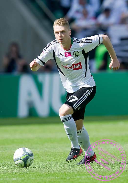 Legia's Dominik Furman controls the ball during T-Mobile Extraleague soccer match between Legia Warsaw and Lechia Gdansk at Pepsi Arena in Warsaw, Poland...Poland, Warsaw, May 05, 2013..Picture also available in RAW (NEF) or TIFF format on special request...For editorial use only. Any commercial or promotional use requires permission...Photo by © Adam Nurkiewicz / Mediasport