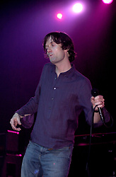 Jarvis Cocker (vocals, guitar, keyboards) on stage during Pulps final concert at the Magna Centre 14th December 2002