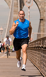 man jogging on the Brooklyn Bridge in New York