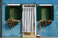 August, 2005, Burano, Italy --- Cloth covered entrance to a house on the Island of Burano, near Venice.  Burano is famous for its pastel houses and for lace making. --- Image by © Owen Franken/Corbis