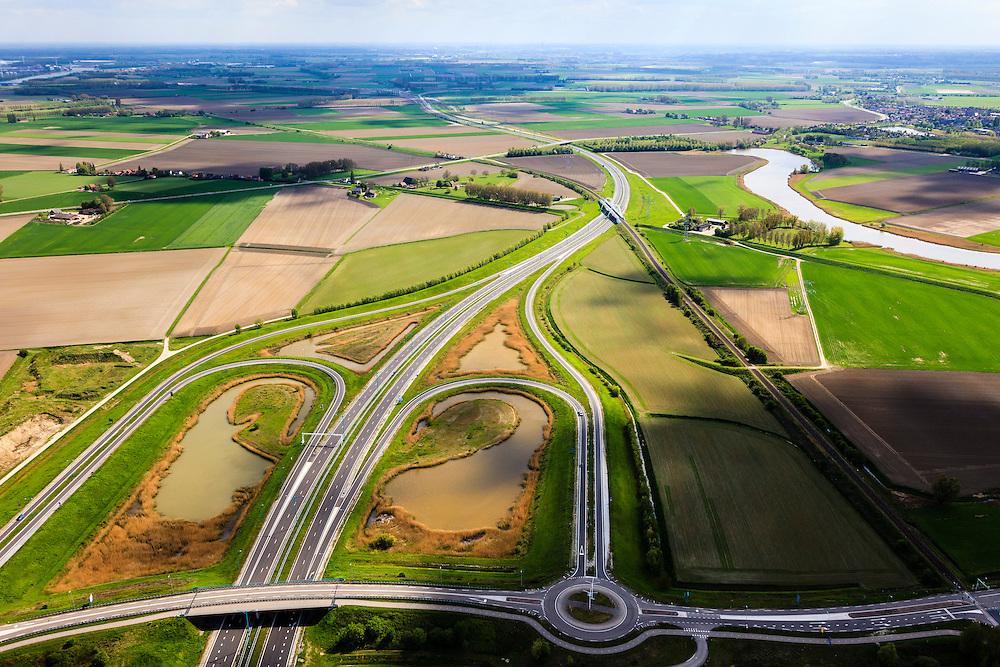Nederland, Zeeland, Terneuzen, 09-05-2013; Zeeuws-Vlaanderen, Terneuzen. Westerscheldetunnelweg, N62, verbindt de zuidelijk ingang van de Westerscheldetunnel met het landelijke wegennet. Kruising met Herbert H. Dowweg (N252) en de spoorbaan.<br /> Landscape near Terneuzen (Zeeuws-Vlaanderen), the roadway to the tunnel in the Westerschelde between the agricultural fields.<br /> luchtfoto (toeslag op standard tarieven);<br /> aerial photo (additional fee required);<br /> copyright foto/photo Siebe Swart.