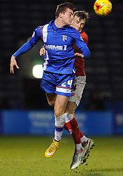 Bristol City's Aden Flint challenges for the header with Gillingham's Ben Dickenson - Photo mandatory by-line: Dougie Allward/JMP - Mobile: 07966 386802 - 06/01/2015 - SPORT - football - Gillingham - Priestfield Stadium - Gillingham v Bristol City - Johnstone Paint Trophy - Area final