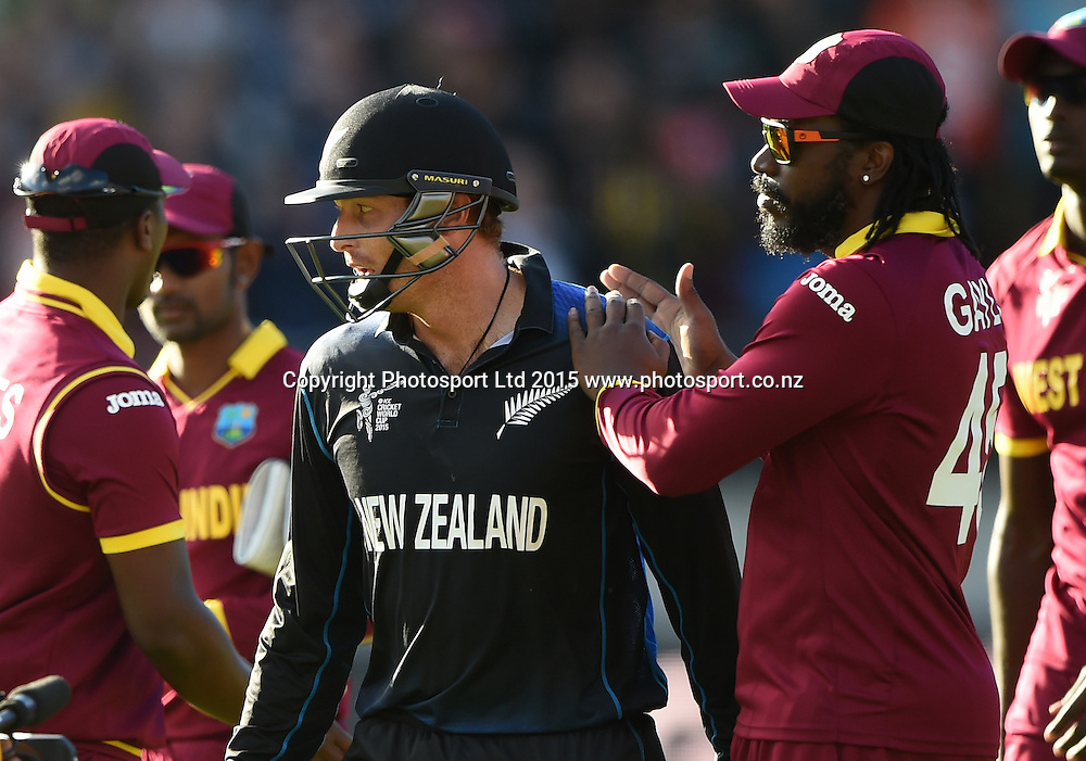 Martin Guptill leaves the field unbeaten on 237 as he is congratulated by Chris Gayle during the ICC Cricket World Cup quarter final match between New Zealand Black Caps and the West Indies, Wellington, New Zealand. Saturday 21March 2015. Copyright Photo: Andrew Cornaga / www.Photosport.co.nz
