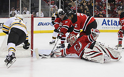 Apr 10; Newark, NJ, USA; New Jersey Devils goalie Johan Hedberg (1) makes a save on Boston Bruins right wing Michael Ryder (73) during the first period of their game at the Prudential Center.