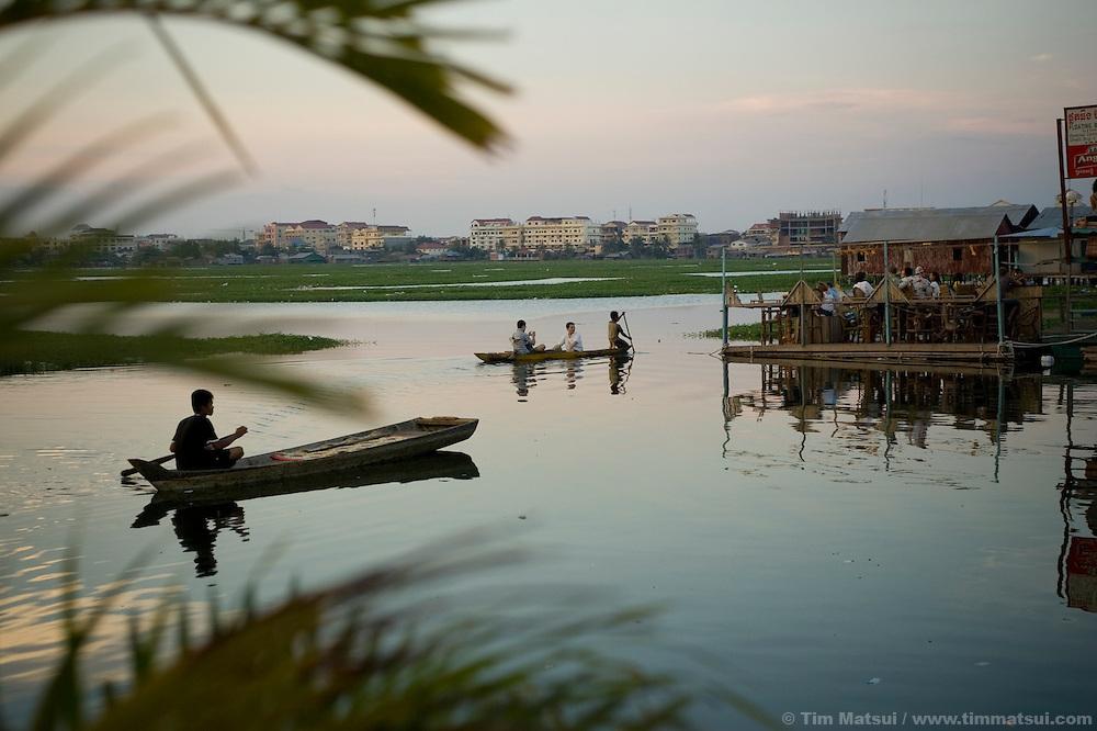 Boat traffic on Boeng Kak lake in the center of Phnom Penh, Cambodia
