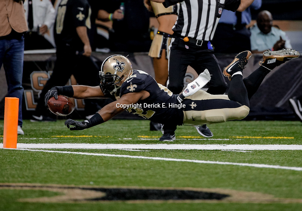 Dec 17, 2017; New Orleans, LA, USA; New Orleans Saints running back Mark Ingram (22) dives forward for the pylon but is ruled out of bounds prior to the goal line during the first quarter against the New York Jets at the Mercedes-Benz Superdome. Mandatory Credit: Derick E. Hingle-USA TODAY Sports