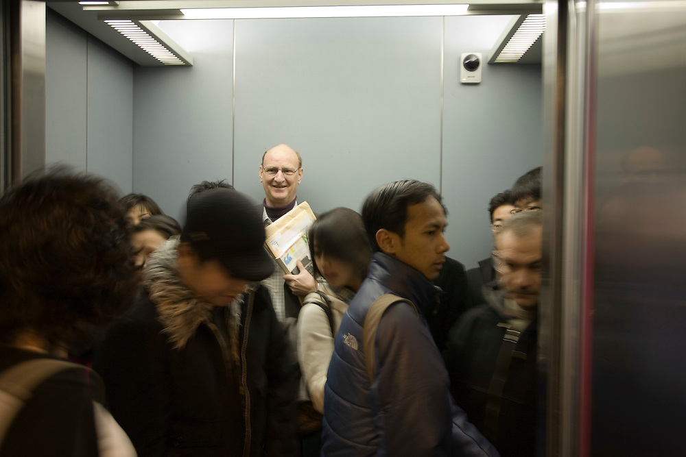 Waseda  University,  Dean  Paul Snowden,  School of International Liberal Studies(SILS ) rides in elevator to class with students.