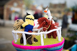 © Licensed to London News Pictures. 27/04/2016. Thirsk UK. Picture shows  a knitted horse racing scene on a bollard in Thirsk that has been Yarn Bombed. Under the cover of Darkness 300 Yarn bombing street artist's have covered the Town centre of Thirsk, the group has covered bollards, flower pots, the bus stop, tree's, benches, even the local police station. The knitted creations took over 750 balls of wool & have been placed along the route of the Tour De Yorkshire which will pass through the town during it's final stage from Middlesborough to Scarborough on Sunday.  Photo credit: Andrew McCaren/LNP