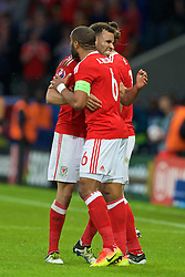LILLE, FRANCE - Friday, July 1, 2016: Wales Hal Robson-Kanu celebrates the fist goal with captain Ashley Williams during the UEFA Euro 2016 Championship Quarter-Final match against Belgium at the Stade Pierre Mauroy. (Pic by Paul Greenwood/Propaganda)