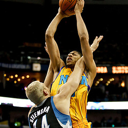 Dec 14, 2012; New Orleans, LA, USA; New Orleans Hornets power forward Anthony Davis (23) is fouled by \Minnesota Timberwolves center Greg Stiemsma (34) during  the first quarter of a game at the New Orleans Arena. Mandatory Credit: Derick E. Hingle-USA TODAY Sports