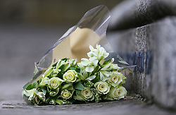 © Licensed to London News Pictures. 16/06/2017. Birstall, UK.  Flowers left at the ceremony.  500 school children from nine schools in the Birstall area that have joined together in Heckmondwike Green to sing songs in memory of MP Jo Cox this morning. Today marks the one year anniversary of the death of Labour MP for Batley & Spen Jo Cox. Jo Cox died after being shot & stabbed by Thomas Mair outside Birstall library where she had been due to hold a constituency surgery. Photo credit: London News Pictures