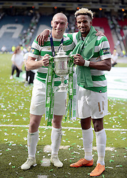 Celtic's Scott Brown (left) and Scott Sinclair pose with the Scottish Cup after victory against Motherwell in the William Hill Scottish Cup Final at Hampden Park, Glasgow.