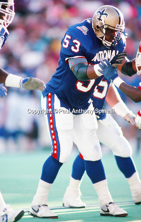 New Orleans Saints linebacker Vaughan Johnson (53) works his way around a block during the 1990 NFL Pro Bowl between the National Football Conference and the American Football Conference on Feb. 4, 1990 in Honolulu. The NFC won the game 27-21. (©Paul Anthony Spinelli)