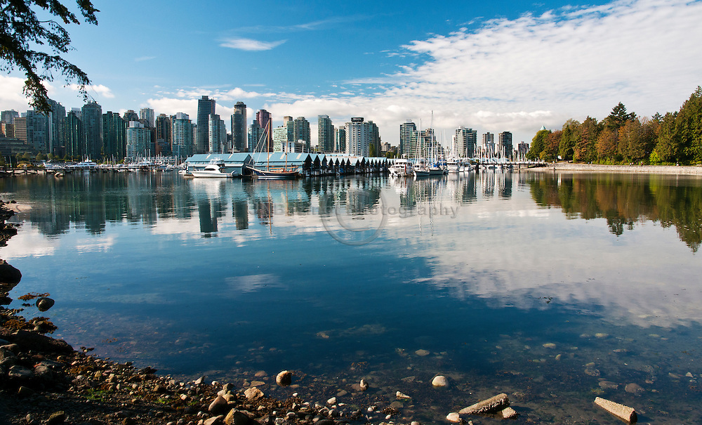 The harbour is bounded by the Financial District to the south and Stanley Park to the north.