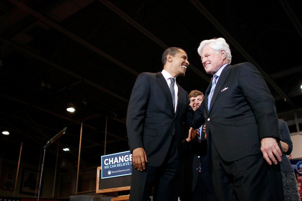 Washington, Jan. 28, 2008 - Presidential candidate Sen. Barack Obama, (D-IL), center left, and Sen. Ted Kennedy (D-MA), center right, wave to supporters during a campaign stop for Presidential candidate Sen. Barack Obama at American Univeristy in Washington on Monday, Jan. 28, 2008.  Kennedy endorsed Obama's White House bid today.///Sen. Barack Obama, center left, and Sen. Ted Kennedy, center right.