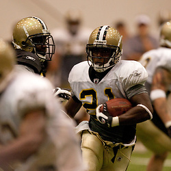 08 August 2009: Running back Mike Bell (21) looks for running room during the New Orleans Saints annual training camp Black and Gold scrimmage held at the team's indoor practice facility in Metairie, Louisiana.