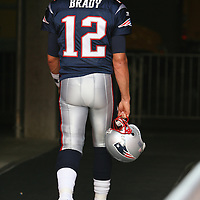 New England quarterback Tom Brady (12) leaves the playing field prior to an NFL football game between the New England Patriots and the Tampa Bay Buccaneers at Raymond James Stadium on Thursday, August 18, 2011 in Tampa, Florida.   (Photo/Alex Menendez)