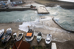 © Licensed to London News Pictures. 01/01/2018. Portreath, UK. Large waves crash over Portreath harbour wall. The remainders of Storm Dylan have brought strong winds and heavy rainfall, and Storm Eleanor is due to arrive on Wednesday. Photo credit : Tom Nicholson/LNP