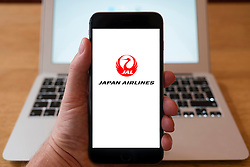Using iPhone smartphone to display logo of JAL, Japan Airlines