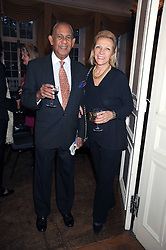 Musician CONFREY PHILLIPS and his wife CAROLE at a Literary Evening to celebrate the publication of Masters & Commanders by Andrew Roberts held at The Polish Institute and Sikorski Museum, 20 Princes Gate, London SW7 on 1st October 2008.