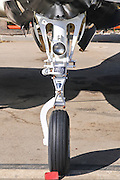 close-up of the front wheel mechanism on a private plane