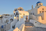 Woman in Oia,Santorini, Kyclades,South Aegean, Greece,Europe<br /> Model release 0009