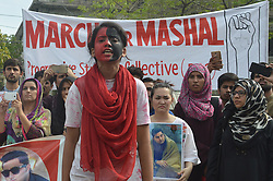 April 13, 2018 - Lahore, Punjab, Pakistan - Pakistani activists of Civil Society and Ravi Students Federation hold a justice for Mashal rally, outside Lahore Press Club in Lahore. Mashal Khan was brutally murdered by a mob over false blasphemy allegations a year ago in Abdul Wali Khan University Mardan. (Credit Image: © Rana Sajid Hussain/Pacific Press via ZUMA Wire)