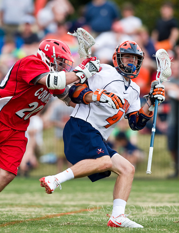 Virginia Cavaliers A Gavin Gill (4) is checked by Cornell Big Red M John Glynn (20).  The #1 ranked Virginia Cavaliers defeated the #4 ranked Cornell Big Red 14-10 at Klockner Stadium on the Grounds of the University of Virginia in Charlottesville, VA on March 8, 2009.