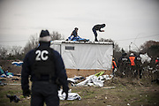 March 1, 2016 - Calais, France -<br /> <br /> Destruction Of Calais Jungle Camp Continues<br /> <br /> A couple takes refuge on the roof of his hut. Man pleads prefecture leave them in the southern part of the jungle, in Calais, France, on March 1, 2016. Authorities return to clear migrant shelters from more parts of the 'Jungle' migrant camp in Calais and try to move people to shipping containers on another part of the site. French demolition teams began dismantling huts yesterday. Resistance is expected to continue and overnight riot police fired teargas at migrants who were throwing stones. A court ruling on Thursday approved a French Govt plan to clear part of the site. Authorities say approx 1,000 migrants are to be affected out of 3,700 people - many of them refugees from Syria and Iraq - who are thought to live in the camp. Mayor of Calais Natacha Bouchart has demanded the closure of the site for several weeks following several recent clashes with police  <br /> ©Exclusivepix Media