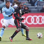 NEW YORK, NEW YORK - March 12:  Patrick Nyarko #12 of D.C. United is challenged by Ethan White #3 of New York City FC during the NYCFC Vs D.C. United regular season MLS game at Yankee Stadium on March 12, 2017 in New York City. (Photo by Tim Clayton/Corbis via Getty Images)