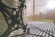 BERLIN - BERLIN WALL MEMORIAL - Chapel of Reconciliation;Bernauer Strasse - Neubau der Kapelle der Versoehnung auf dem ehemaligen Mauerstreifen. Die Versoehnungskirche wurde 1985 von DDR-Grenztruppen  gesprengt; Architekten: Sassenroth + Reitermann, Berlin,Stampflehmbau: Martin Rauch, Bauherr: Evangelische Versöhnungsgemeinde; Hier: Aussenansicht - altes Kreuz;29.08.2000 ©  christian  JUNGEBLODT.