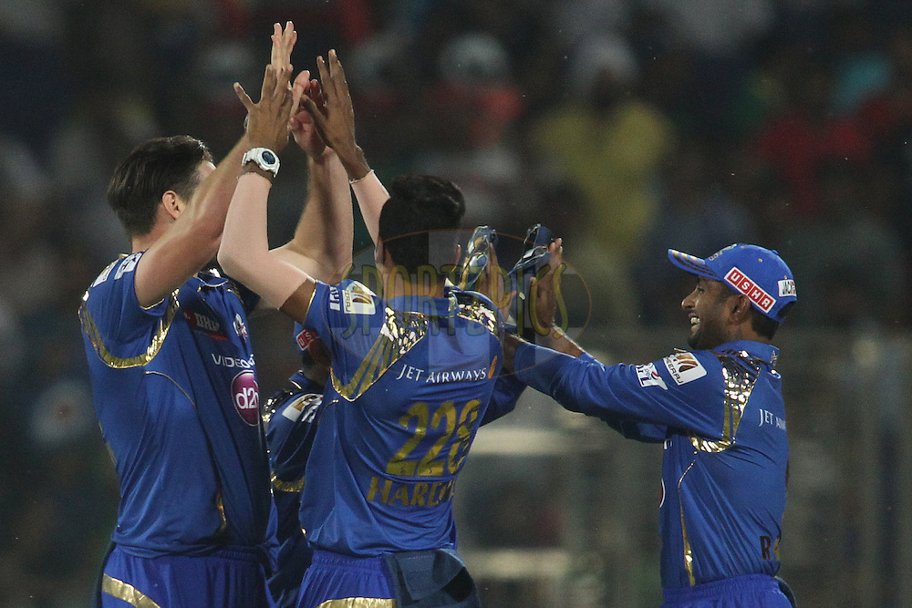 Mitchell McClenaghan of Mumbai Indians is congratulated by Hardik Pandya of Mumbai Indians for getting Mayank Agarwal of the Delhi Daredevils wicket during match 21 of the Pepsi IPL 2015 (Indian Premier League) between The Delhi Daredevils and The Mumbai Indians held at the Ferozeshah Kotla stadium in Delhi, India on the 23rd April 2015.<br /> <br /> Photo by:  Shaun Roy / SPORTZPICS / IPL