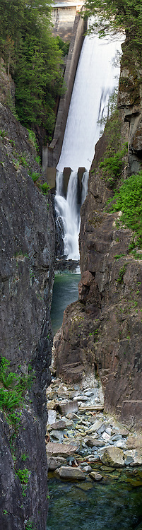 Water from the Capilano Reservoir flows over Cleveland Dam into Ring Bolt Pool at Capilano River Regional Park in North Vancouver, British Columbia, Canada.  Photographed from the viewing area at the end of Second Canyon Trail.