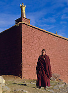 Monk in front of Reting Monastery, Tibet, China