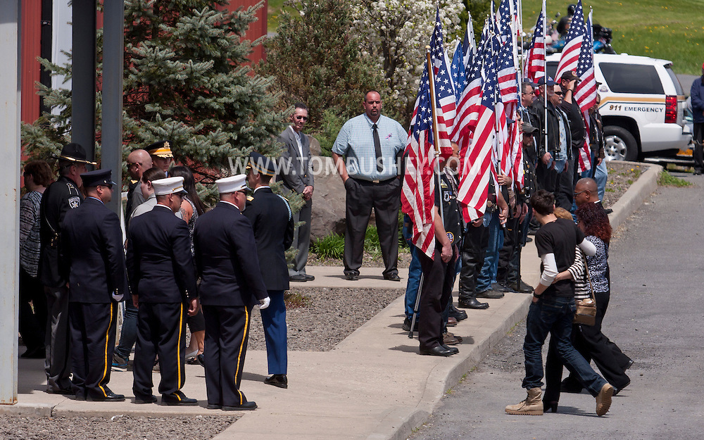 Accord, New York  - The family of  U.S. Army Sgt. Shawn M. Farrell II walk into Skate Time for a private memorial service on May 7, 2014. Farrell died April 28 when forces attacked his unit with small arms fire in Afghanistan.