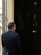 © Licensed to London News Pictures. 30/04/2012. London, UK . David Cameron enters  Downing Street after answering questions in Parliament 30 April 2012. Photo credit : Stephen Simpson/LNP