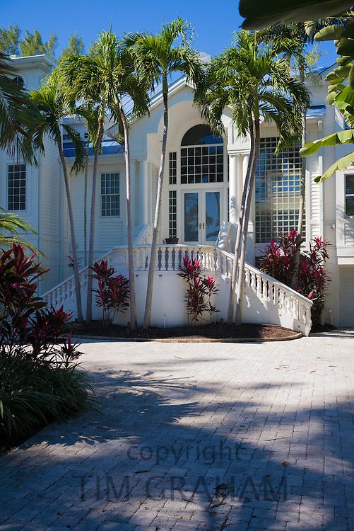 Luxury, stylish, winter home surrounded by palm trees on Captiva Island in Florida, USA