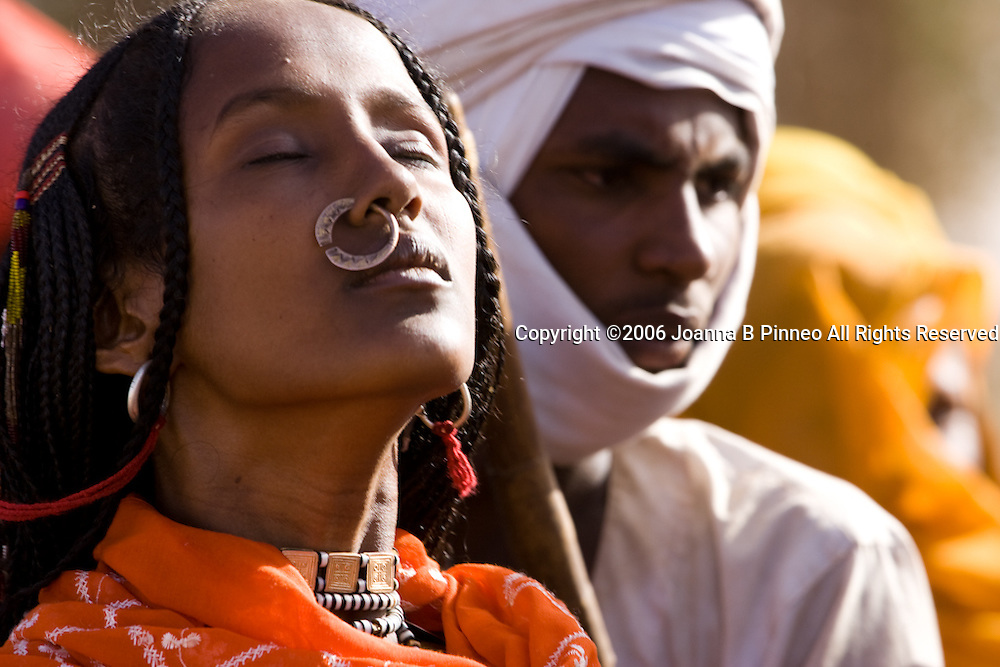 Shanabla woman dances  at a wedding celebration near El Obeid, Sudan. A nomadic tribe they raise camels.