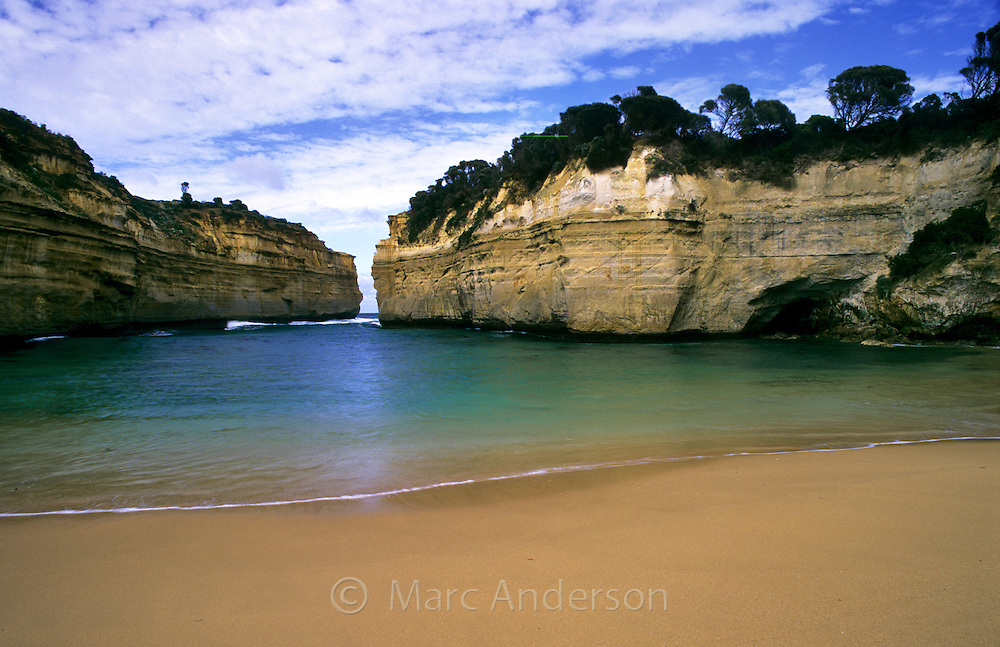A beautiful bay and beach surrounded by cliffs, Loch Ard Gorge, Australia.